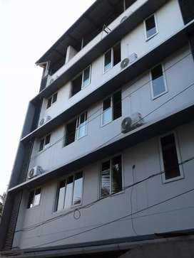 10 cent 11300 sqft 27 furnished rooms at kakkanad near civil station