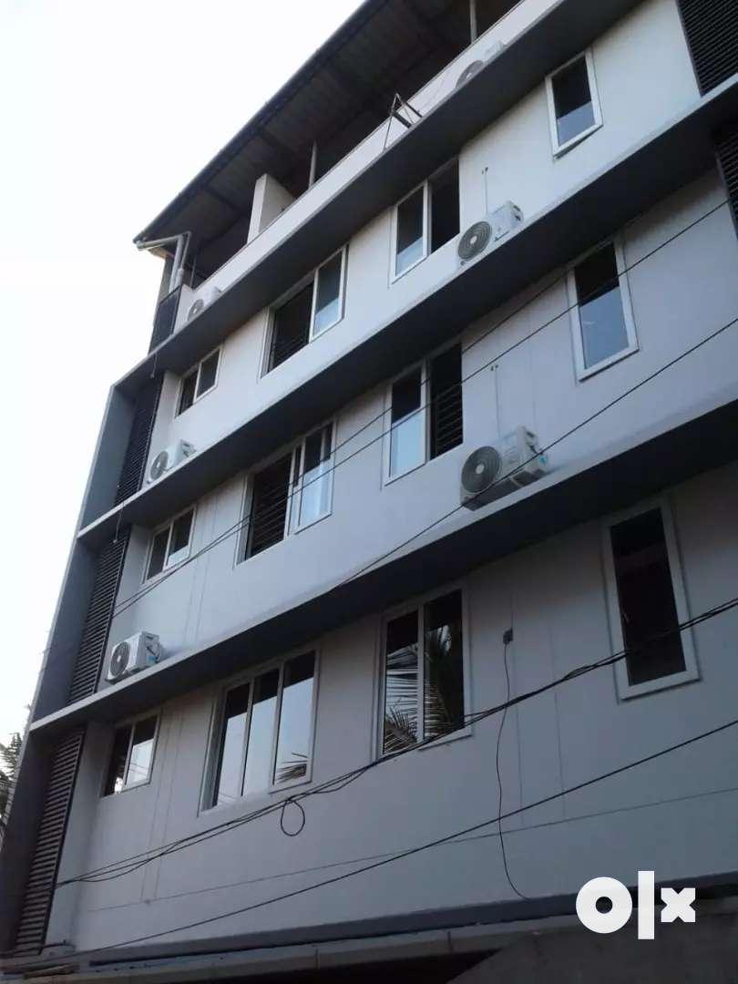 10 cent 11300 sqft 27 furnished rooms at kakkanad near civil station 0