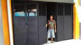 Pintu Garasi Lipat dan Rel Handerson