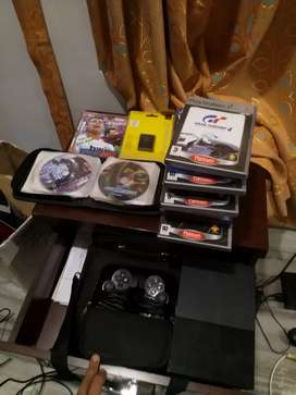 PS2 with 2 controllers and more than 100 game CDs
