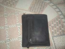 Medium sized leather wallet with zip pocket for keys coins etc