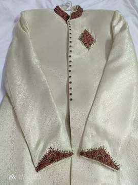 Wedding sherwaani with embroidered on neck and sleeves