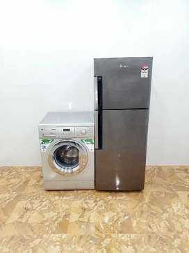 Grey Whirlpool double door 250 litre and silver LG 6.5 kg front load