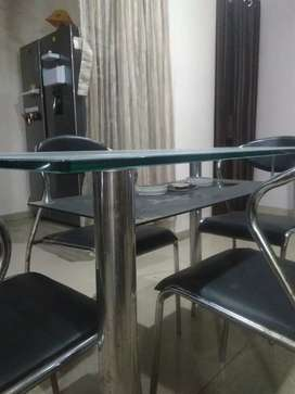 Four seater glass top dining table set