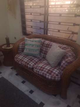 Cane sofa and  cane dining table