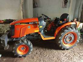 Kubota Neostar A211N tractor with trailer and tiller
