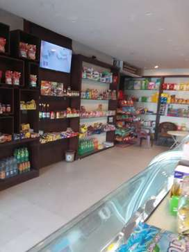 Only indoor decore, wooden racks, glass shelves,cabinets,cash counter