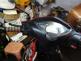 Red colour scootey in good condition