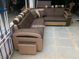 L shape corner sofa with pillows and puffy