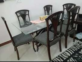 6 seater glass top & wooden base dining table