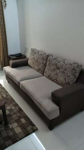 Three, Two and one seater sofa set with glass top central table