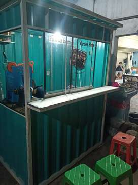 Container booth model kaca geser