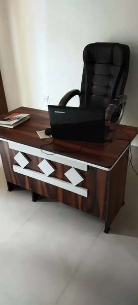 Office table and chair for sale.