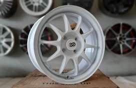 Veleg racing sigra Enkei 15 incchi pcd4X100 silver Swift ignis Brio