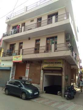 One basement +4 shops +6rooms rent 70k income