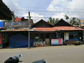 9 cent plot(3 shops facing road and backside house at Valoor JN)