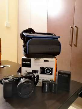 Sony a6000 with 16-50 OSS lens + 4 nos battery pack