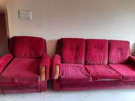 A set of sofa in maroon colour