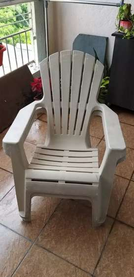 Two Plastic garden chairs.