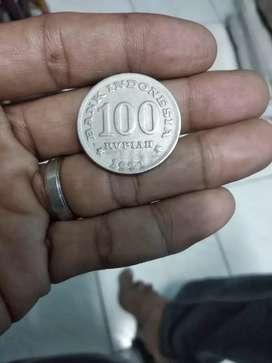 dimaharkan koin antik tebaL Rp.100 rumah gadang
