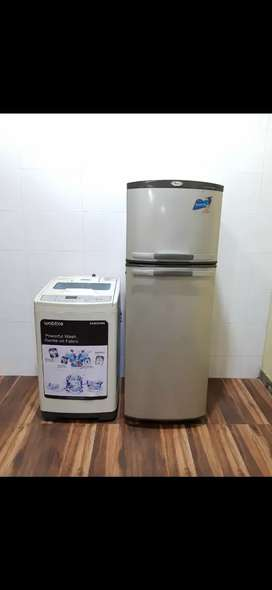 Silver whirlpool refrigerator and smsung top load washing machine ₹₹
