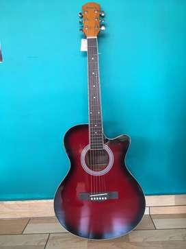 Red color guitar in good condition.