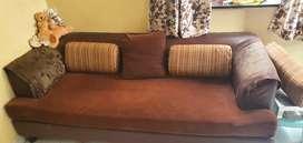 Brown sofa with cushion