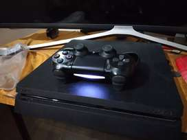 PlayStation 4 with multiple games