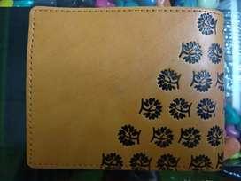 Genuine fancy design brown color wallet.