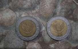 Uang koin pecahan 1000 rupiah.