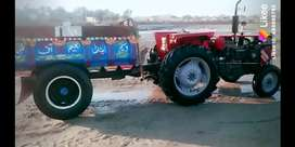 Messi 240 tractor with trolley good condition