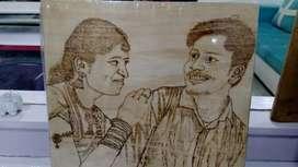Pyrograpy art wood and hit drawing