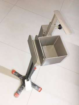 Foot operated iron sanitizer stand.