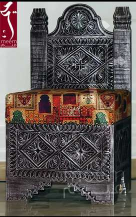 A hand-carved traditional Swati Coffee Chair Set along with a table