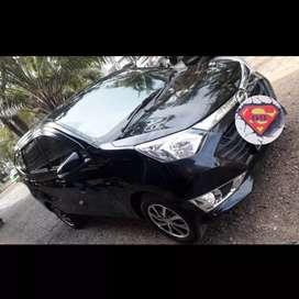 Daihatsu Sigra 1.2 R Matic tahun 2017 warna hitam. Istimewa KM rendah