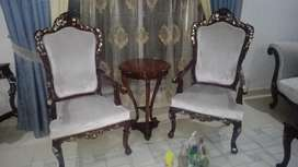 A pair of chairs and a table