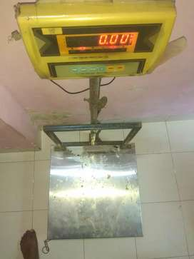 Good condn weighing machine cost :