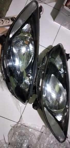 Headlamp lampu depan mazda 2