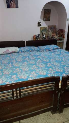 Solid big 7feet teak bed in good condition, along with Kurlon Mattress