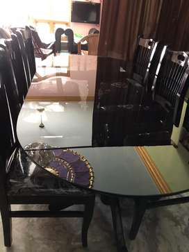 Glass dining table with 6 chairs. Only genuine candidates can approach