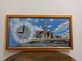 Jam kaligrafi dan bingkai