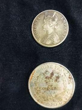 1 rupee victoria coin and a republic francaise