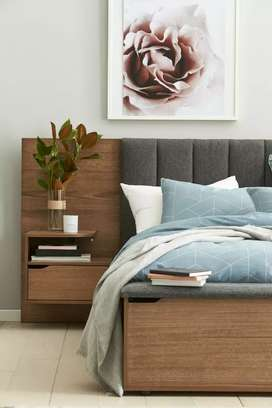 New stylish king size bed with side tables in wood colour