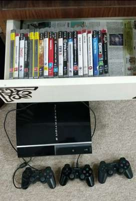 Play Station 3 with 3 remotes with lots of game CD's