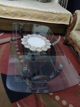 Glass top center table with wooden frame. No scratches.