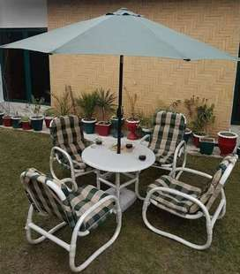 4 Chairs one Table one side pool Umbrella
