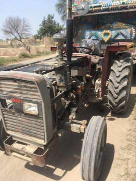 Messy 240 tractor with trolley