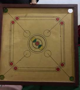 Carrom board in use