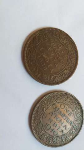 Old coins of one quarter anna