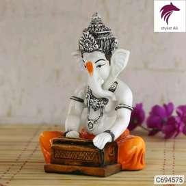 Ganesha playing hormonium